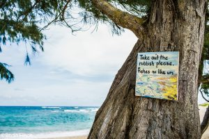 Sign saying to pack your trash in Mahaulepu